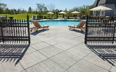 Exterior Design: Bali Travertina Paver Techo Bloc With Outdoor Lounge Chairs And Fence Swimming Pool Designs, Swimming Pools, Patio Slabs, Outdoor Patios, Outdoor Decor, Outdoor Lounge, Exterior Design, Landscape Design, Backyard