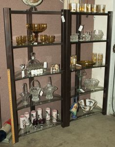 SHOWCASE YOUR TREASURES WITH THIS PAIR OF DISPLAY SHELVES MADE OF METAL WITH GLASS SHELVING. MEASURE 28 IN. W X 60 IN. H X 14 IN. D.