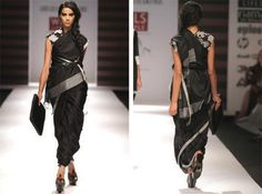 Black silk saree with elephant rickshaw motif tied with leather belt from Abraham & Thakore, 2010 (on display at the Victoria and Albert Museum)