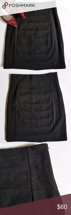 """WHBM Instantly Slimming Dark Gray Pencil Skirt Instantly slimming pencil skirt from White House Black Market.  In dark gray color.  Very stretchy thick forgiving material.  Fold over elastic waist with side zipper.  Fully Lined.  In excellent like new condition, wore once or twice.  Skirt: 67% Viscose 29% Nylon 4% Spandex  Lining: 74% Nylon 26% Spandex  14.5"""" Waist 21"""" Length White House Black Market Skirts Pencil"""