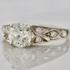 How gorgeous is this antique engagement ring with an old European cut diamond and an incredibly detailed band! So beautiful!