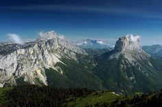 """Grand Veymont and Mont Aiguille (right) in Isère, Rhône-Alpes, France - photo by Mg-k, via Wikipedia;  """"Mont Aiguille is a mesa eroded from the Vercors Plateau in the drainage basin of the Rhône [River]. It is surrounded by steep cliffs and has a height of 6,841 feet.""""  It has a very distinct shape."""