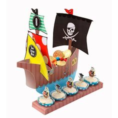 "This pirate ""ship"" features a card centre piece treat holder, ""walk the plank"" cake holder and 16 stickers to personalise it... A must have for any kids pirate party! 