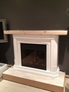 How to transform a store-bought electric fireplace into a striking piece unique to your home