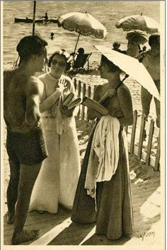 At the beach, ca. 1920. S)