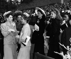 The stars gather at the Hollywood Bowl: Norma Shearer, Ida Lupino, Mary Pickford, Loretta Young, Rita Hayworth, and Barbara Stanwyck Guessing from the hats and flowers, this may be one of the Easter services held at the Hollywood Bowl in the 1940′s