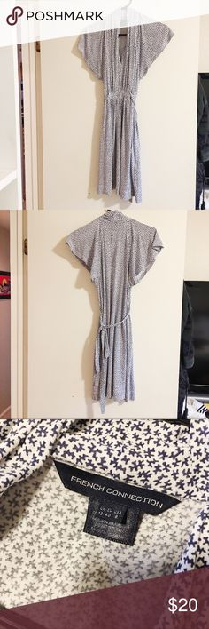 French Connection jersey knit dress One of those classic casual dresses! Navy and white pattern, flutter sleeves. It ties around the waist in the back. Great condition. US 8, but it's forgiving for other sizes as well (I'm a 4-6 and it fits fine). Smoke and pet free home. French Connection Dresses