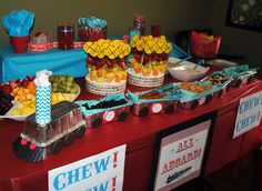 """Snack Train for Train Themed Birthday Party -- (http://EmilyLongDesign.com/MamaBlog.html) inexpensive bread pans from the grocery store filled with treats!  Raisins become """"Coal Car,"""" Pretzels become """"Log Car,"""" etc.  Toilet Paper Roll and Cotton for Smoke Stack, use cookies """"glued"""" with peanut butter for wheels"""