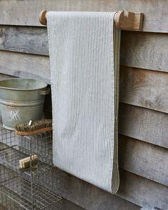 Oak roller towel holder: Labour and Wait