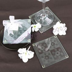 "Snowflake Glass Coasters(set of 2pcs) These beautiful coasters make winter weddings especially elegant, and seasonal parties even more festive. Offer them on your reception tables, or give them away at holiday parties.Each glass coater set includes four 3.5""x3.5"" substantial glass frosted with delicate snowflakes"
