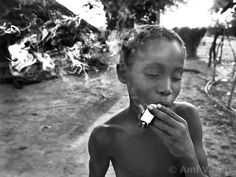 Alio Balde mimics his older brother and makes a fake cigarette out of grass and paper. Increasingly, the boys are moving to the capital of Bissau and abandoning the duties of the village life. Guinea Bissau is ranked as one of the poorest nations in the world and has just come out of a civil war but still village life has remained mostly untouched from most modern influences. Ami Vitale