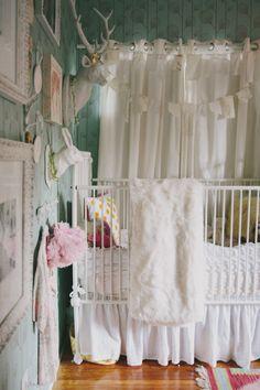 adorable nursery with Ferm Living wallpaper (via Design Sponge)