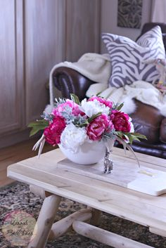 Create a simple centerpiece with artificial peonies for the dining table or coffee table that will brighten your home for spring!