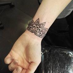 Mandala, wrist tattoo on TattooChief.com