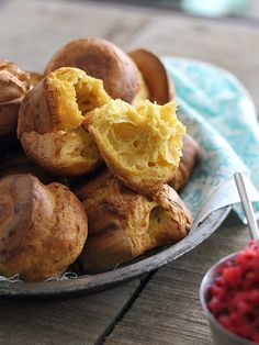 These pumpkin popovers are easily made in the blender and topped with a tart and tangy cranberry relish also made in the blender. Perfect for Thanksgiving!