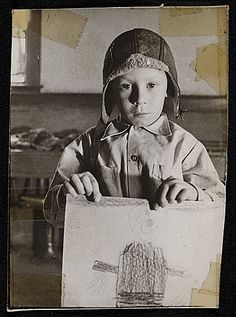 Citation: Source material for Tribute to the American Working People. Boy holding drawing, ca. 1947 / Honoré Desmond Sharrer, photographer. Honoré Sharrer papers, Archives of American Art, Smithsonian Institution.