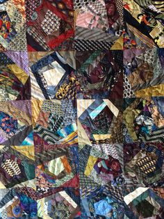This stunning one of a kind quilt consists of 20 crazy and colorful blocks created with repurposed mens vintage and designer neckties. Hundreds of pieces of gorgeous and unique silks with artful designs of fish, flowers, poster art and even wine and cheese...there is so much to look at hiding among the colors and patterns! Not only is this a beautiful work of art for your home but it feels absolutely amazing!  Our process to create this quilt ...  First, we choose only the best neckties (we…