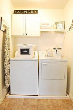 laundry room/ironing board....I like the decor