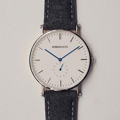 Our Classic Glencoe watch featuring an ultra-thin case, Swiss quartz movement and a unique tweed strap. Minimalist white dial with silver hands and silver case. Dark grey tweed strap with genuine Cool Watches, Watches For Men, Simple Watches, Herren Chronograph, Beautiful Watches, Luxury Watches, Fashion Watches, Mens Fashion, Style Fashion