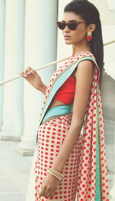 Red polka dots saree on white with blue and gold lace border