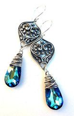 Silver Victorian filigree pendants, Bali silver, Antiqued Sterling silver wire wrapping and blue crystal earrings.