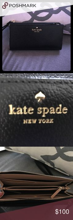 SOLD EBAY-Kate Spade Grand Layton Black Used once... just got it last week and it was just too big for my diaper bag with the twins stuff... like new. MATERIAL embossed cowhide with matching trim capital kate jaquard lining 14-karat light gold plated hardware FEATURES wristlet style wallet with zipper closure 9 credit card slotscenter zipper change compartment exterior zipper compartment Product Dimensions: 9 x 4.7 x 1.5 inches kate spade Bags Clutches & Wristlets
