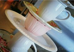 """""""This DIY Cupcake Stand is seriously so easy but it's one of my favorite projects. I had another design friend who made something similar out of all white dishes to replicate a cupcake stand she had seen in a Pottery Barn magazine. I love the simplicity of all white, I really do. I also have my kitchen decor themed around dishes and wanted to make a stand I could leave out year round. My kitchen/dining/living room has some shabby chicish elements..."""""""