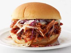 Food Network Magazine's Slow-Cooker Pulled Pork Sandwiches allows the pork and all the drippings to cook for 8 hours before being served on buns with a schmear of barbecue sauce and topped with coleslaw.