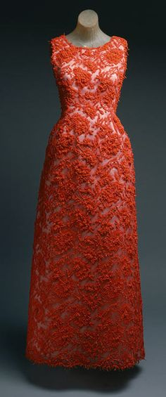 Hubert de givenchy. Evening gown of coral cotton lace re-embroidered with coral-colored beads and coral pieces by Hubert de Givenchy from 1963