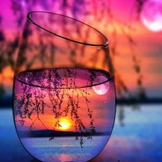 Photography Through the glass of water is visible sunset