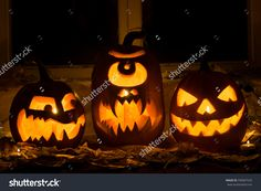 Photo Of Three Pumpkins For Halloween. Embittered, A Cyclops And Evil Pumpkin Against Autumn Leaves And Candles - 330007535 : Shutterstock
