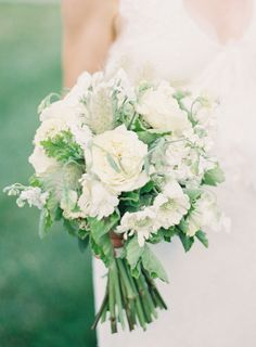 White Wedding Bouquet with Greenery | On SMP: http://www.stylemepretty.com/2013/12/02/st-louis-garden-wedding-from-clary-photo | Photography: Clary Photo