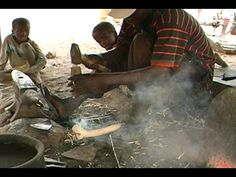 The Camara family of blacksmiths from Balanzan in the Mande region of Mali, West Africa making dabas (hand hoes) in their forge. Baba and Segui Camara. Check...