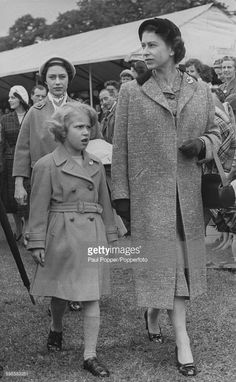 Queen Elizabeth II and her daughter Princess Anne, followed by Princess Margaret, attend the final day of the Royal Windsor Horse Show in Home Park, Windsor, May 11th 1957.