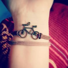 """I want to ride my bycicle!""-bracelet. Bit boho."