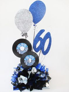 Metallic tissue base, records & faux balloons (number & name optional) 60th Birthday Party Decorations, Disco Party Decorations, Music Theme Birthday, Disco Birthday Party, Music Themed Parties, 70s Party, 70th Birthday Parties, Birthday Centerpieces, 60 Birthday