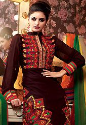 Take the fashion industry by storm in this beautiful embroidered suit. The dazzling dark brown crepe churidar suit have amazing embroidery patch work is done with resham and stone work. Beautiful embroidery work on kameez is stunning. The entire ensemble makes an excellent wear. Matching santoon churidar and green, yellow and red chiffon dupatta is available with this suit. Slight Color variations are possible due to differing screen and photograph resolutions.