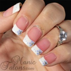 """French Manicure with Flowers: """"I started with a base of one coat of Couture American. American is a pink tinted, sheer polish. I then added the French style tips with Couture Ooh La La French. The flowers and dots are Couture Lavender Lace and the centers of the flowers are ss4 crystals from Born Pretty Store."""" ~Michelle"""