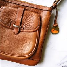 Dooney and Bourke Brown Leather Crossbody Authentic. Classic. Gorgeous. Gentle to no exterior wear and tear, a could minor stains on the interior. Practically brand new condition! Soft durable leather, gentle wear on the hardware, and ready for a new home! Dooney & Bourke Bags Crossbody Bags
