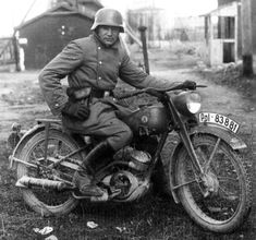A dispatch rider on a Ardie 125 motorcycle