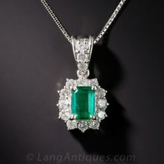 Although modestly proportioned (.73 carat to be exact), emeralds don't come any greener, brighter or beautiful than this gorgeous gem presented in a classic estate pendant crafted in platinum and sparkling all around and on the loop with small bright white round diamonds totaling .56 carat. Late-twentieth century and beautifully bargain priced.1 1/2 by 7/16 inch, adjustable platinum chain.