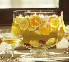 Many events whether it be a traditional wedding, anniversary celebration or baby shower, enjoys serving a nice punch.  What a great idea to display your punch in a beautiful display - whether it's spiked or not. #party,#wedding,#reception