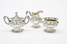 AN AMERICAN STERLING SILVER TEA AND COFFEE SERVICE - by Morton Auctioneers & Appraisers