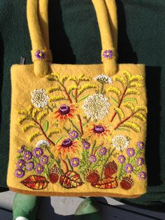 My bag....dyed with golden rod on felt and embroidered with autumn flowers