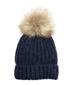 Rib-knit hat in a wool blend with a large faux fur pompom on top. Free delivery with code 6011.