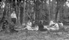 """Photo: picnic in a wooded area, by Harry Walker, 1900-1949. Credit: University of Houston Digital Library; Wikimedia Commons. Read more on the GenealogyBank blog: """"Our Ancestors' Summer Picnics & Recipes."""" https://blog.genealogybank.com/our-ancestors-summer-picnics-recipes.html"""