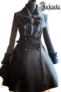 Elegant, gothic lolita: Black coat with faux fur details. Lace collar. Gold brooch.