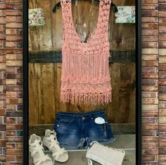 Coral Boho Fringe Top Super cute sheer crochet boho top features a lace mesh body and crochet fringes.   Fit: Slightly Loose, Slight Stretch. Delusive  Tops