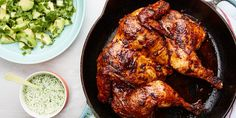 """This cumin- and paprika-spiced number gets added punch from an addictively tangy green sauce and a crisp, bright avocado and cucumber salad. Spatchcocking—an easy and fun technique that involves removing the backbone to """"flatten"""" the bird before cooking—makes for quick roasting and produces juicy results."""