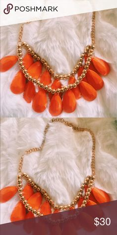 Orange Teardrop necklace A row of glimmering orange  teardrops hangs from gold gleaming beads and a ring-linked chain to create this unique statement necklace. This necklace is from a very popular store in Australia called Colette. Completely new. #jewelry #statementjewelry Colette Hayman Jewelry Necklaces